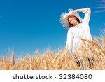 Young Happy Woman In Grain Field