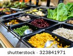 close up of salad bar in... | Shutterstock . vector #323841971