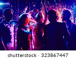 Stock photo group of guys and girls dancing in the night club 323867447