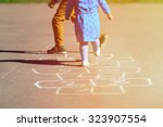 Kids Playing Hopscotch On...