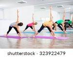 four girls practicing yoga ... | Shutterstock . vector #323922479