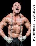 Muscular Man Shouting While...