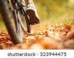 foot on pedal of bicycle in... | Shutterstock . vector #323944475