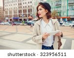 young stylish pretty woman with ... | Shutterstock . vector #323956511