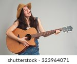 Young Girl Guitar Play. Gray...