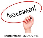 Small photo of Man Hand writing Assessment with black marker on visual screen. Isolated on white. Business, technology, internet concept. Stock Photo