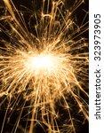 burning sparkler on a black...   Shutterstock . vector #323973905