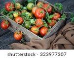 fresh garden tomatoes in a... | Shutterstock . vector #323977307