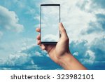 hand to hold mobile phone on... | Shutterstock . vector #323982101