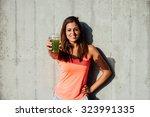 sporty woman offering detox... | Shutterstock . vector #323991335