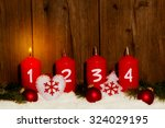 Advent Candles With Snow In...
