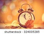 Vintage Alarm Clock On Yellow...