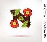 drawing floral logo letter.... | Shutterstock .eps vector #324037619