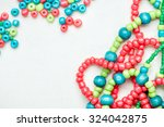 colored glass beads and thread... | Shutterstock . vector #324042875