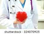 doctor with stethoscope... | Shutterstock . vector #324070925