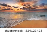 sunrise on the beach of... | Shutterstock . vector #324123425