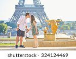 young romantic couple kissing... | Shutterstock . vector #324124469