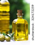 olives and olive oil   Shutterstock . vector #324172259