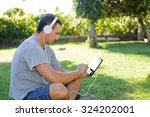 young man relaxing with a... | Shutterstock . vector #324202001
