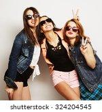 fashion portrait of three... | Shutterstock . vector #324204545