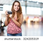 young woman holding a vintage... | Shutterstock . vector #324205319