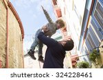 a young dad with her son... | Shutterstock . vector #324228461