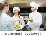cook gives to young waitress... | Shutterstock . vector #324269987