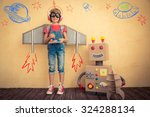 happy kid playing with toy... | Shutterstock . vector #324288134