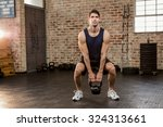 man lifting kettlebell at the... | Shutterstock . vector #324313661