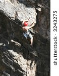 a rock climber works his way up ... | Shutterstock . vector #3243275