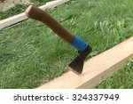 axe in a pine board against a... | Shutterstock . vector #324337949