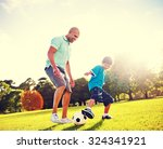 little boy playing soccer with... | Shutterstock . vector #324341921