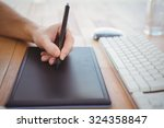 cropped hand of man using... | Shutterstock . vector #324358847