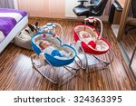baby twins lying down in... | Shutterstock . vector #324363395