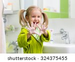 Child Washing Hands And Showin...