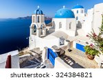 blue domes in oia  santorini... | Shutterstock . vector #324384821