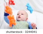 baby playing with toys | Shutterstock . vector #3244041