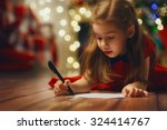 small child writes the letter... | Shutterstock . vector #324414767