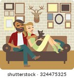 young couple relaxing on sofa... | Shutterstock .eps vector #324475325
