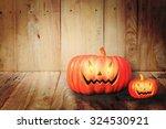 halloween pumpkin on wooden... | Shutterstock . vector #324530921