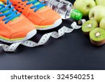sport shoes  fruits   bottle of ... | Shutterstock . vector #324540251