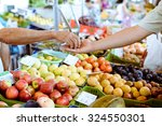 Picture of marketplace with different fruits. Buyer