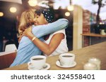 two multi ethnic affectionate... | Shutterstock . vector #324558401