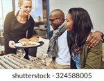 waitress serving food to an... | Shutterstock . vector #324588005
