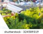 cctv surveillance camera on top ... | Shutterstock . vector #324589319