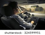 man driving a car | Shutterstock . vector #324599951