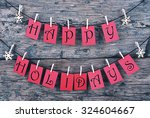 Stock photo vintage or shabby chic wooden rustic background red tags with happy holidays hanging on a line 324604667