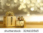 Golden Gift Boxes On Abstract...