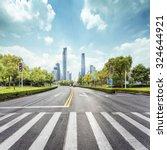 empty road with zebra crossing... | Shutterstock . vector #324644921