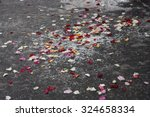 Stock photo rose petals and rice scattered on a grey surface 324658334
